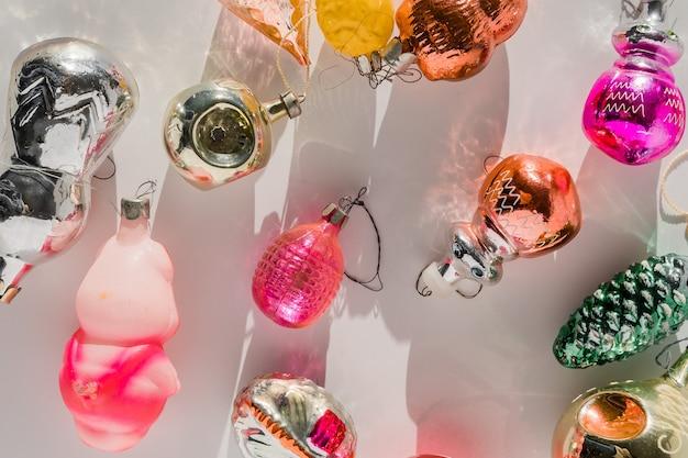 Retro style christmas tree baubles on white background