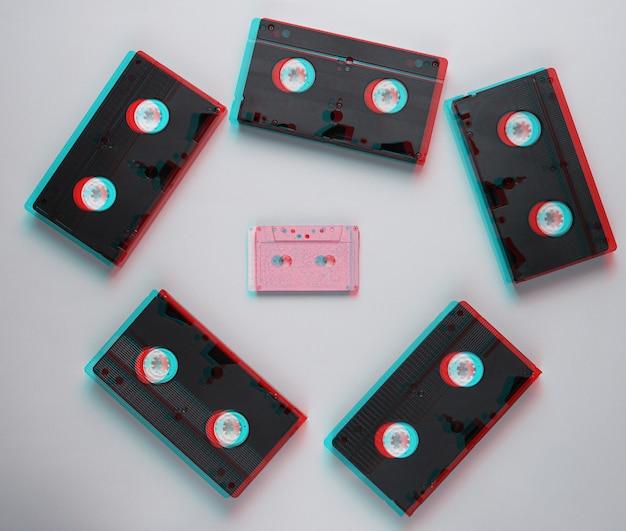 Retro style minimalism. video cassette, audio cassette on a gray