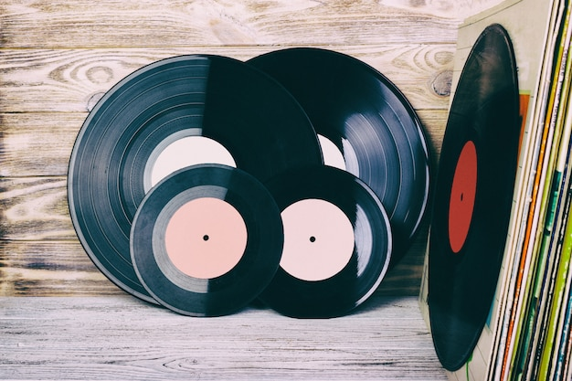 Retro styled image of a collection of old vinyl record lp's with sleeves