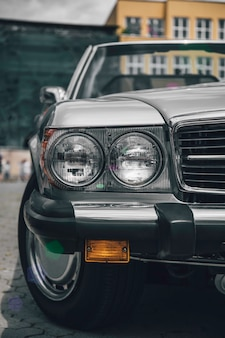 Retro styled image of a front of a green classic car.