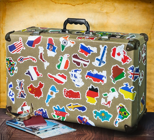 Retro suitcase with stickers on the floor