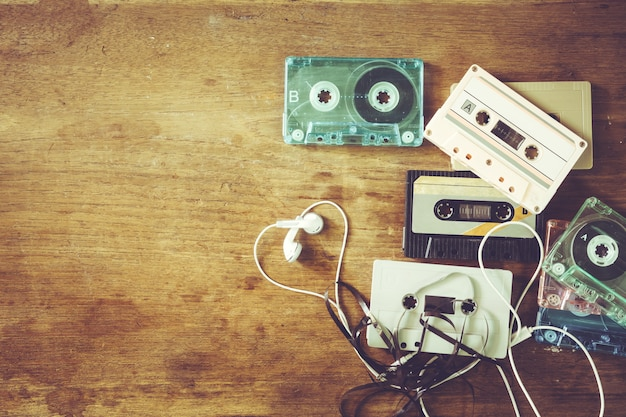 Retro technology of cassette recorder music with retro tape cassette on wood table.