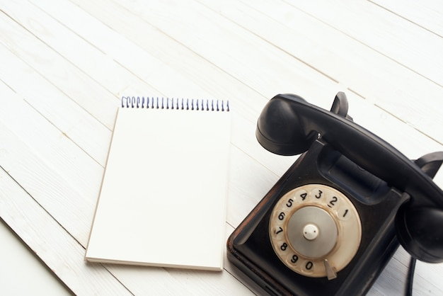 Retro telephone he communication office notepad wooden background object