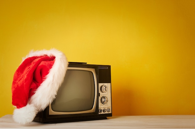 Retro television with christmas hat