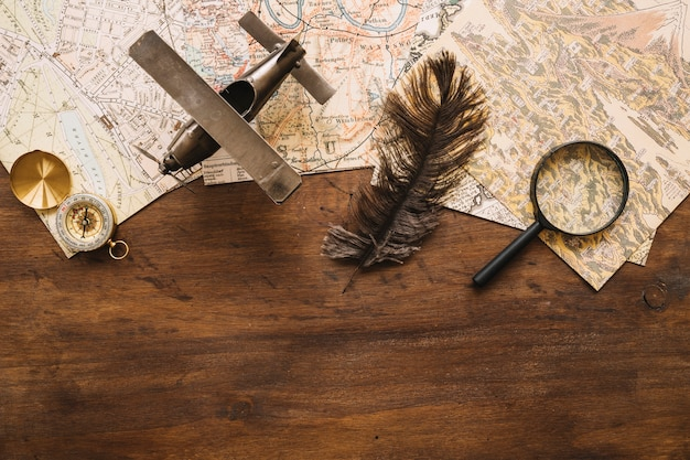 Retro travel supplies on wooden tabletop