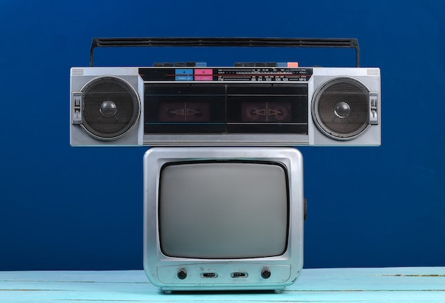 Retro tv receiver with audio tape recorder on a classic blue. retro media