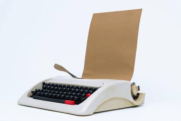 Retro typewriter with blank paper sheet on white.
