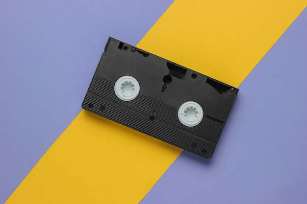 Retro video cassette on a yellowpurple background