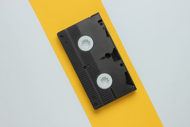 Retro video cassette on a yellowwhite background