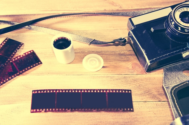Retro vintage camera on wooden background.