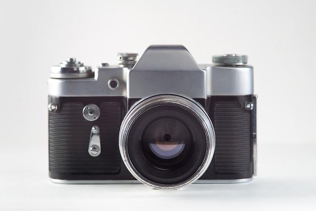 Retro vintage film camera on white background Premium Photo