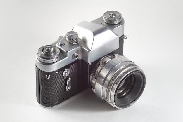 Retro vintage film camera on white background