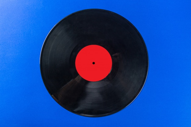 Retro vinyl record on blue
