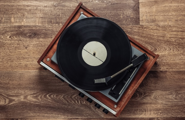 Retro vinyl record player with a record on the floor. 80s. top view