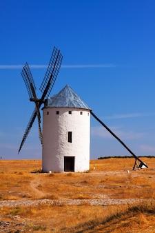 Retro windmill in field