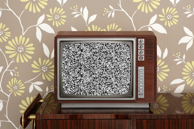 Retro wooden tv on wooden vintage wall