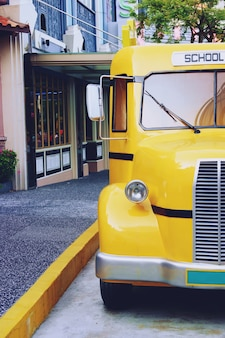 Retro yellow school bus old shiny close up