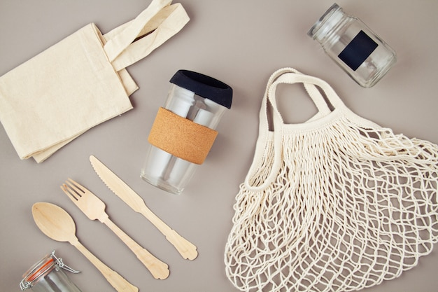 Reusable bags, glass jars and coffee mug for plastic free and zero waste lifestyle