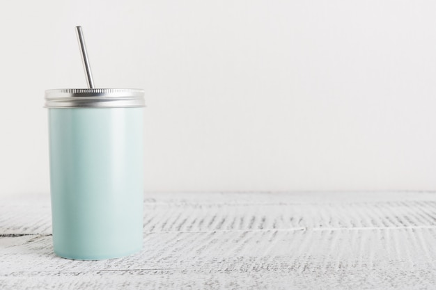 Reusable blue jar with metal straw for summer drinks. individual use. zero waste concept.