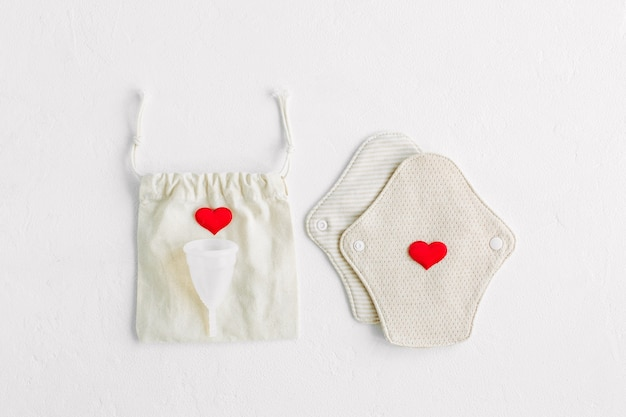 Reusable cloth pads and menstrual cup. zero waste supplies for personal hygiene.  waste-free living.