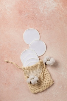 Reusable cotton pads on pink background