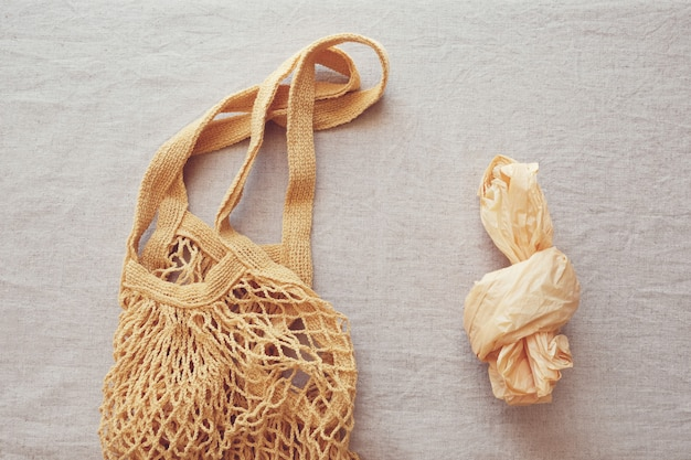 Reusable cotton shopping bag and plastic bag, plastic free and zero waste concept