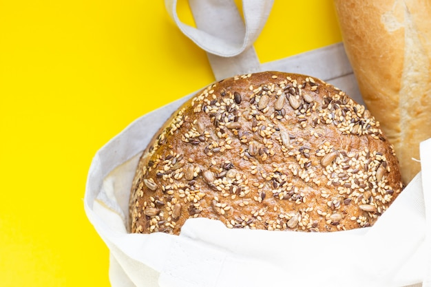 Reusable cotton textile shopping bag with fresh bread