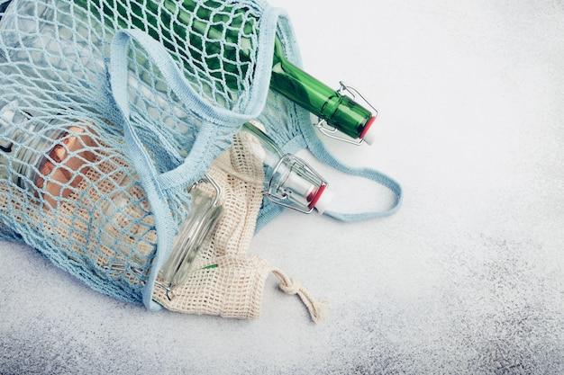Reusable glass bottles and jars in mesh bag