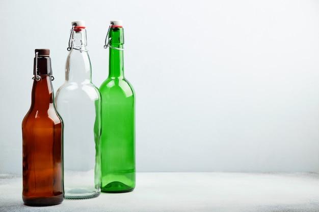 Reusable glass bottles on table.