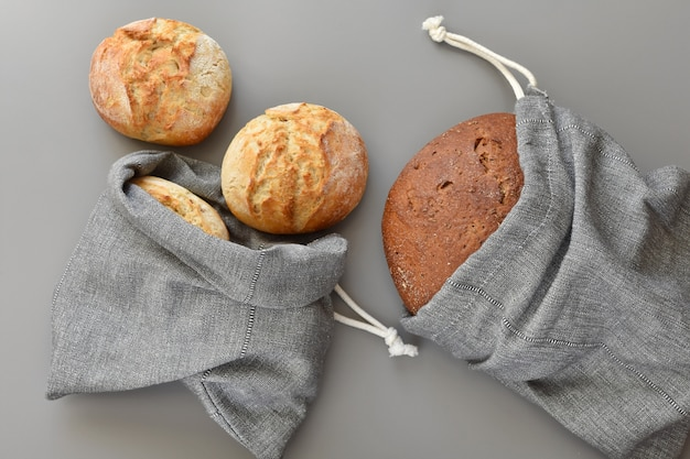 Reusable grocery bags with bread, zero waste shopping.