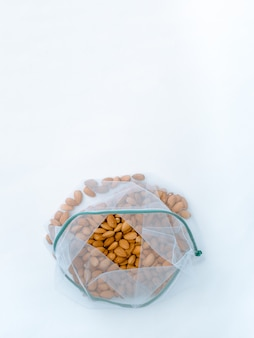 Reusable mesh bags with different nuts.  zero waste concept.