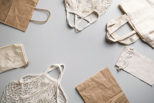 Reusable mesh, cotton and net bag for zero waste lifestyle on grey.