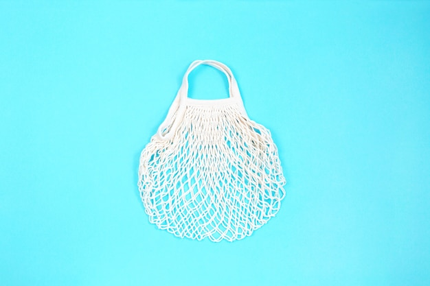 Reusable shopping bag on blue background. ecological concept.