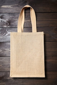 Reusable shopping bag on brown wooden surface