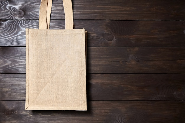 Reusable shopping jute bag on brown wooden table