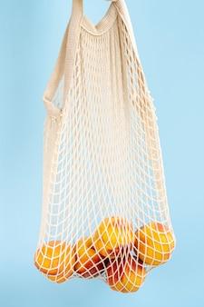 Reusable shopping mesh bag with fruits