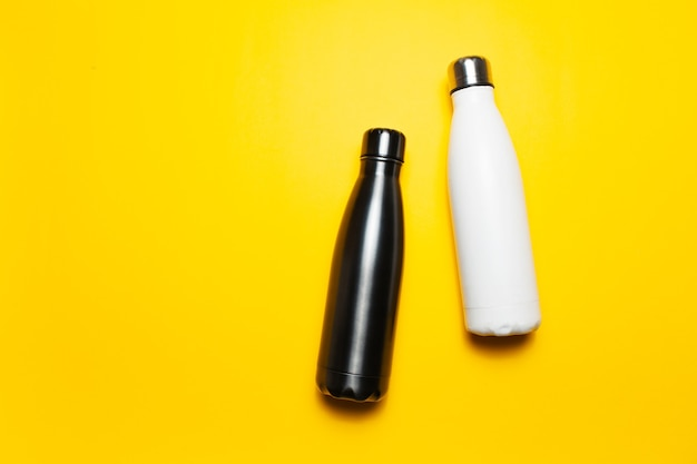Reusable steel thermo water bottles of black and white