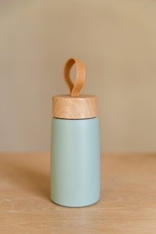 Reusable vacuum eco friendly aluminium cup for take away on wooden table. zero waste.