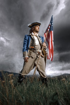 Revolution war soldier with american flag