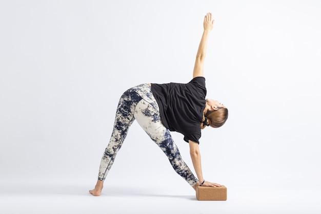 Revolved triangle pose block.yoga posture