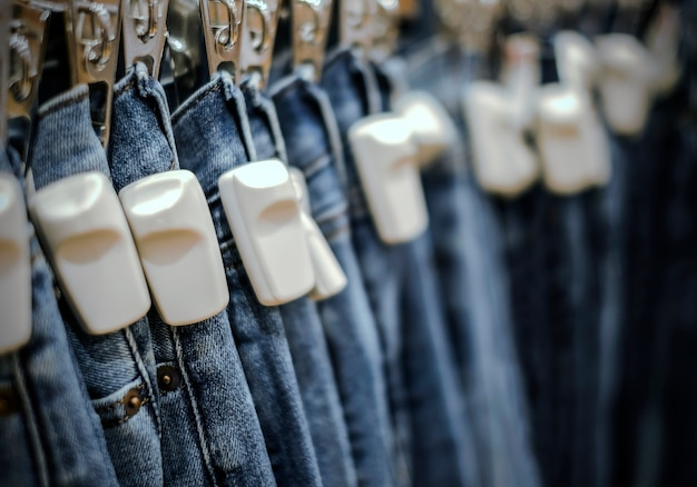 Rfid hard tag on blue jeans pants in shop