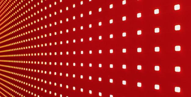 Rgbledスクリーンパネルのテクスチャ。壁紙用のボケ味のあるピクセルledスクリーンのクローズアップ。どんなデザインにもぴったりの真っ赤な抽象的な背景。