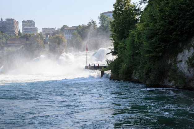 The rhine falls is the largest waterfall in europe in schaffhausen, switzerland. summer landscape, sunshine weather, blue sky and sunny day