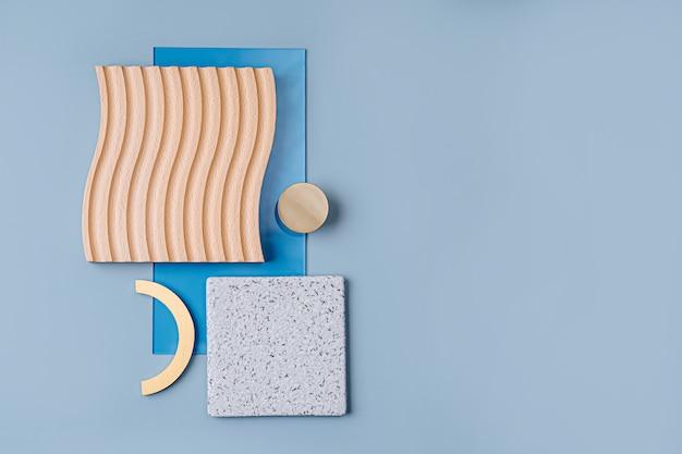 Ребристые и глянцевые стеклянные, каменные и деревянные тарелки с золотым декором на синем фоне. Premium Фотографии