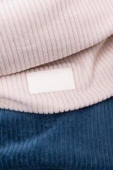 Текстура трикотажной ткани в рубчик. женская модная одежда из натуральных тканей с пустым лейблом