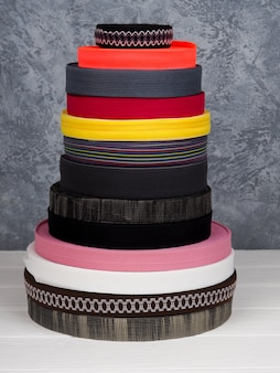 Ribbon of different colors in coils, many multi-colored coils for textile industry, clothing manufacturing