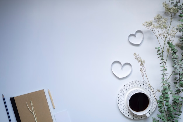 Ribbon hearts, notebook and coffee on white background, valentines day.
