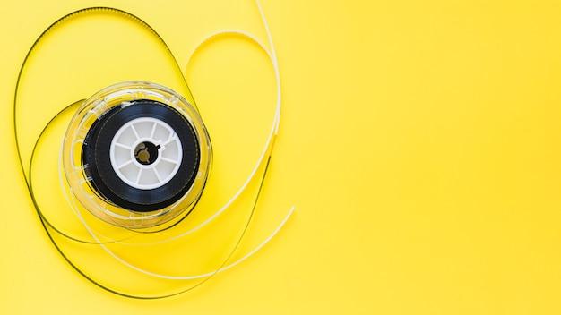 Лента из полоски пленки на желтом