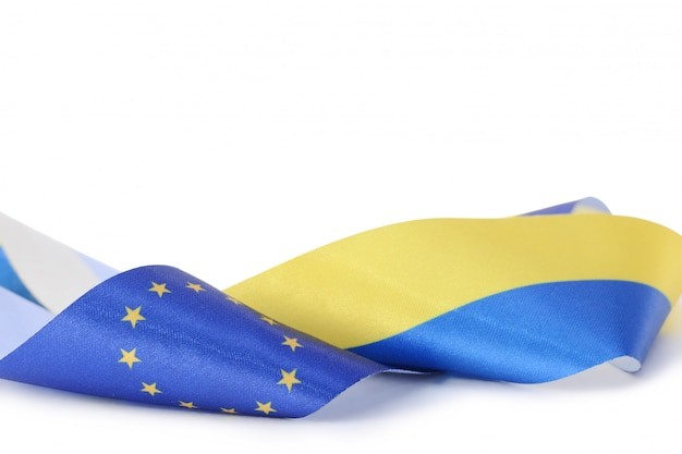 Ribbon with ukrainian and european union flags isolated