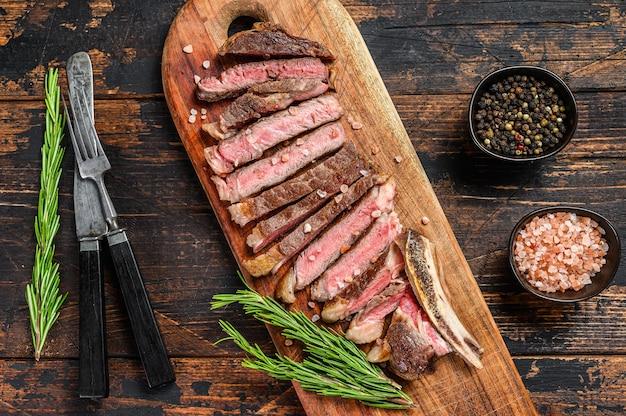 Ribeye steak on the bone. grilled beef meat.